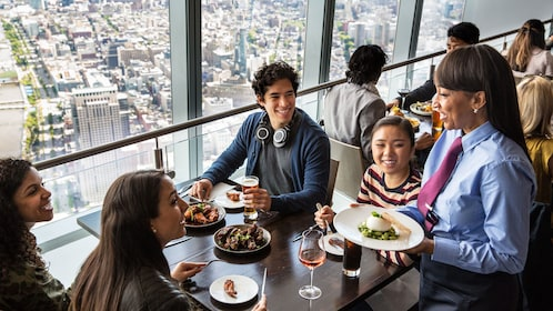 Group of friends enjoy lunch at One World Observatory in New York