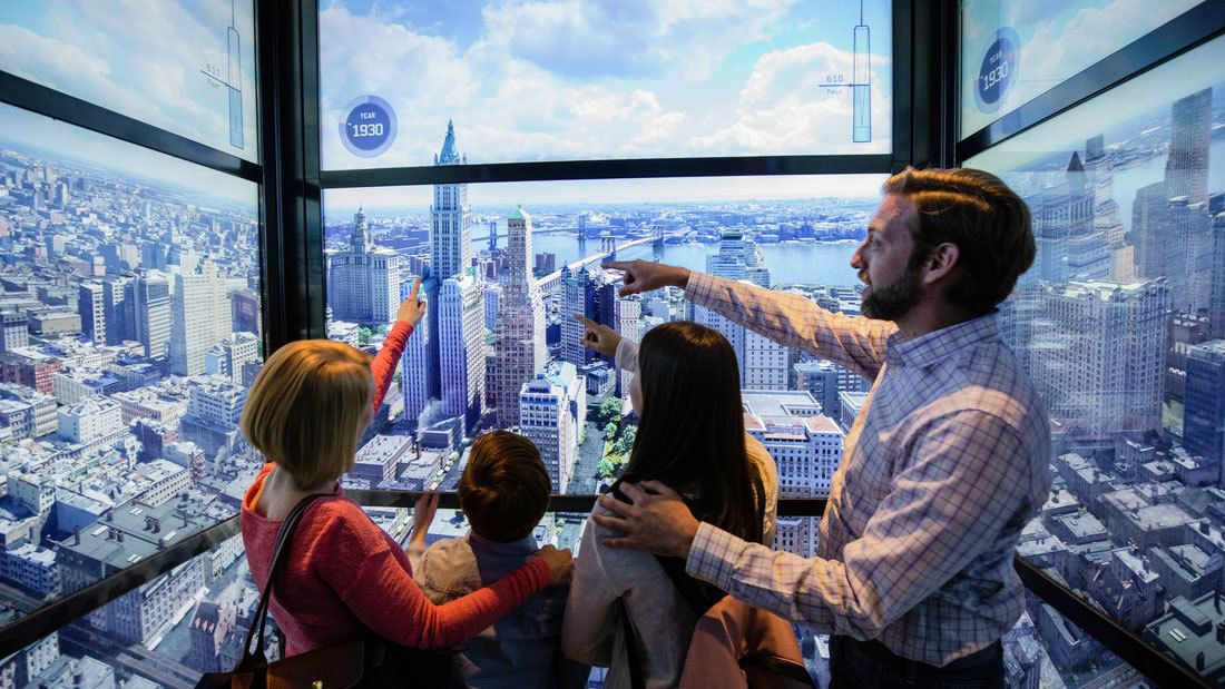 Family looking at interactive at One World Observatory in New York