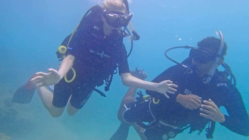 View of a couple on the Scuba Diving adventure in San Juan
