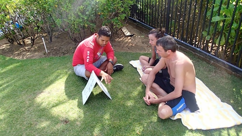 Group learning how to snorkel with instructor in San Juan
