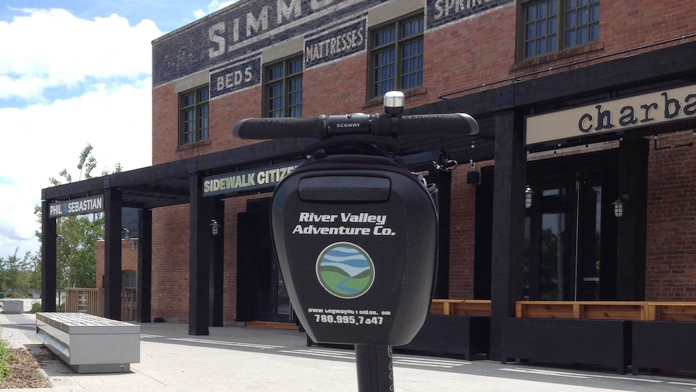 Show item 4 of 4. Segway next to an old building