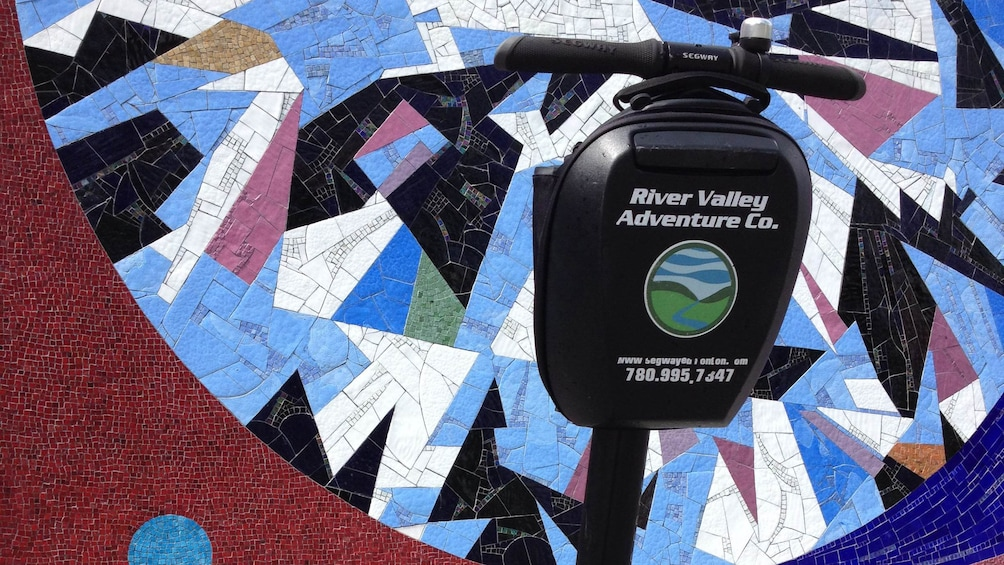 Show item 2 of 4. Segway next to a mosaic