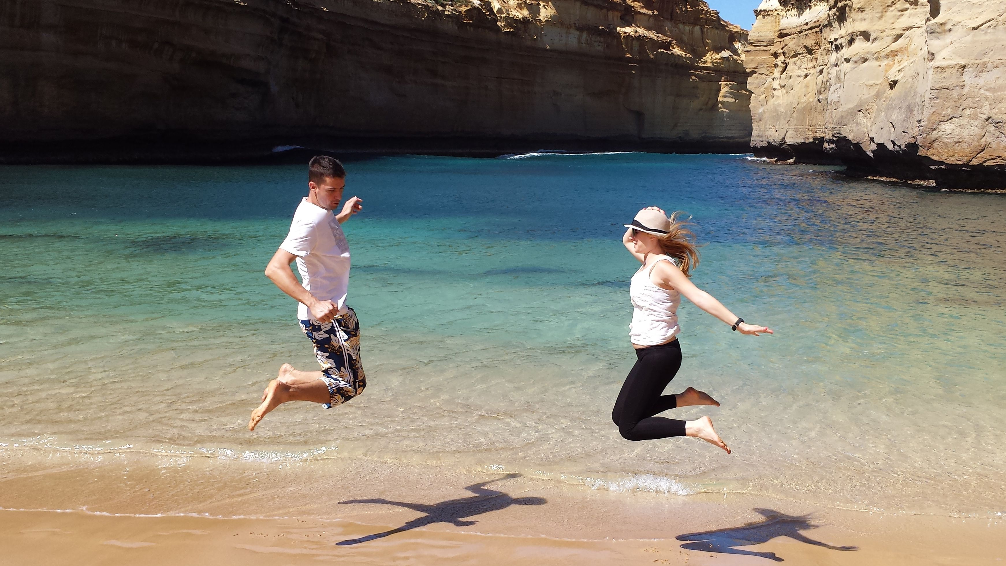 Two people jumping in Loch Ard Gorge