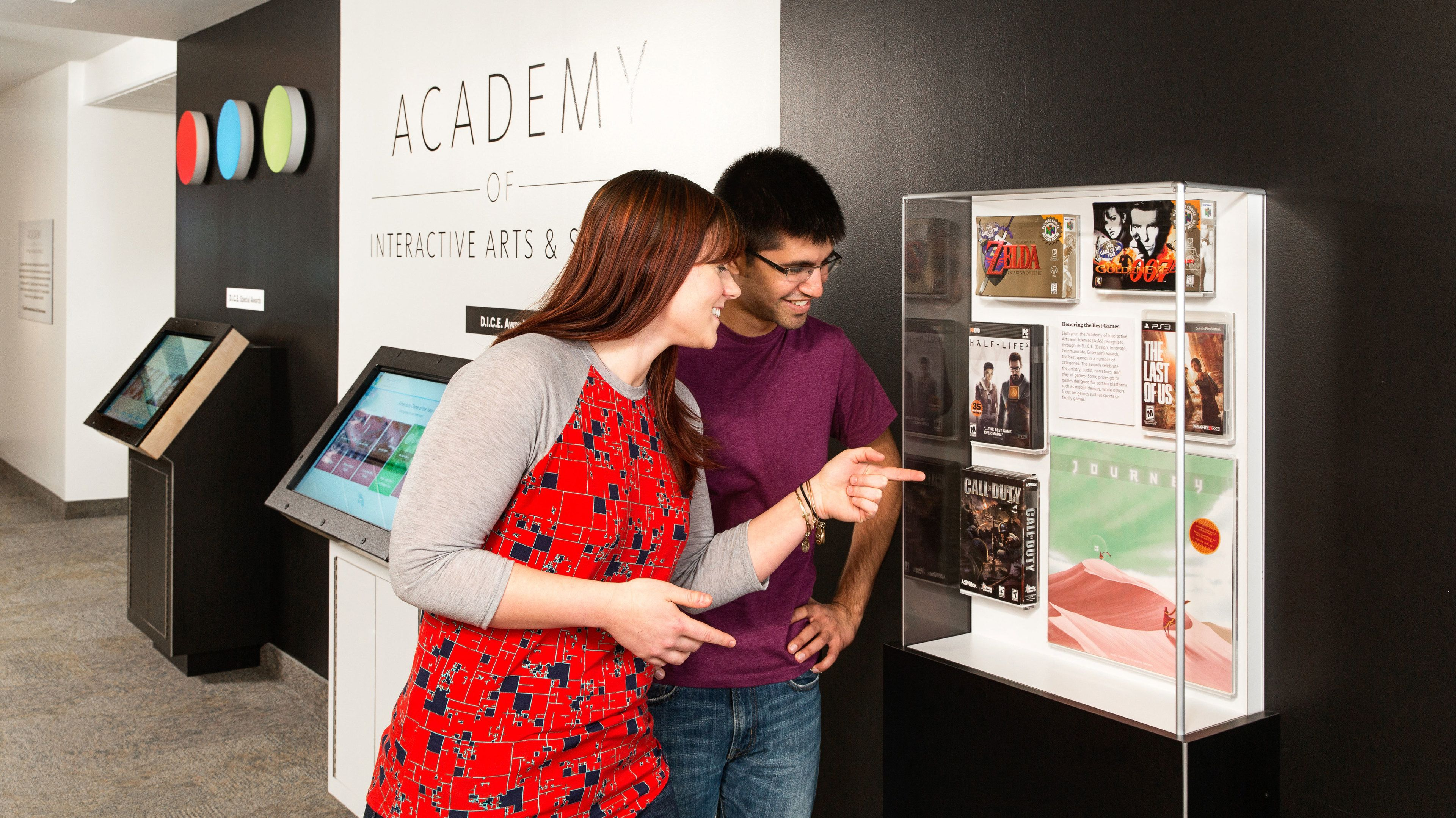 Couple looking at video game exhibit at the Strong Museum of Play