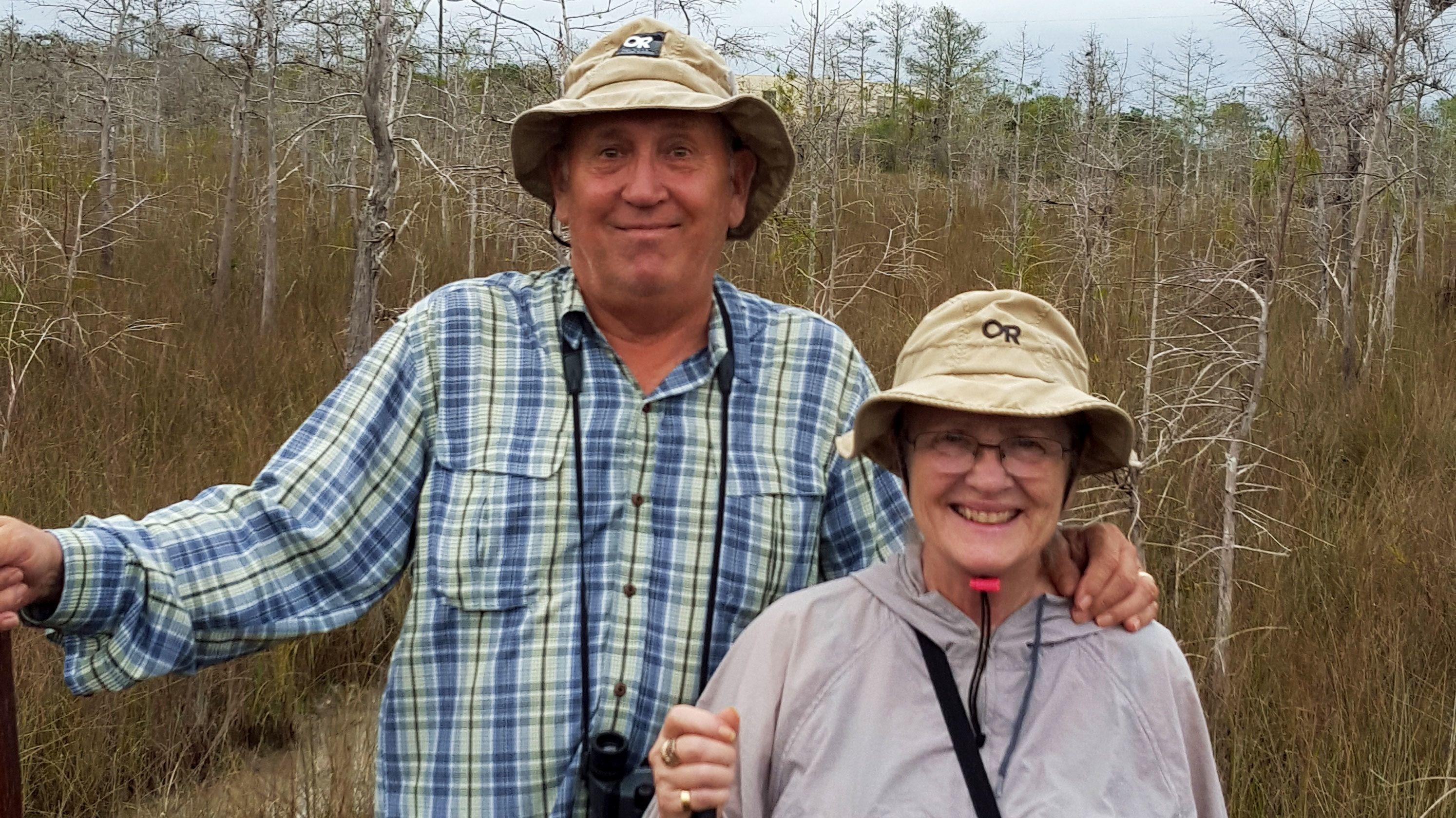 Couple posing for photo while walking through Everglades