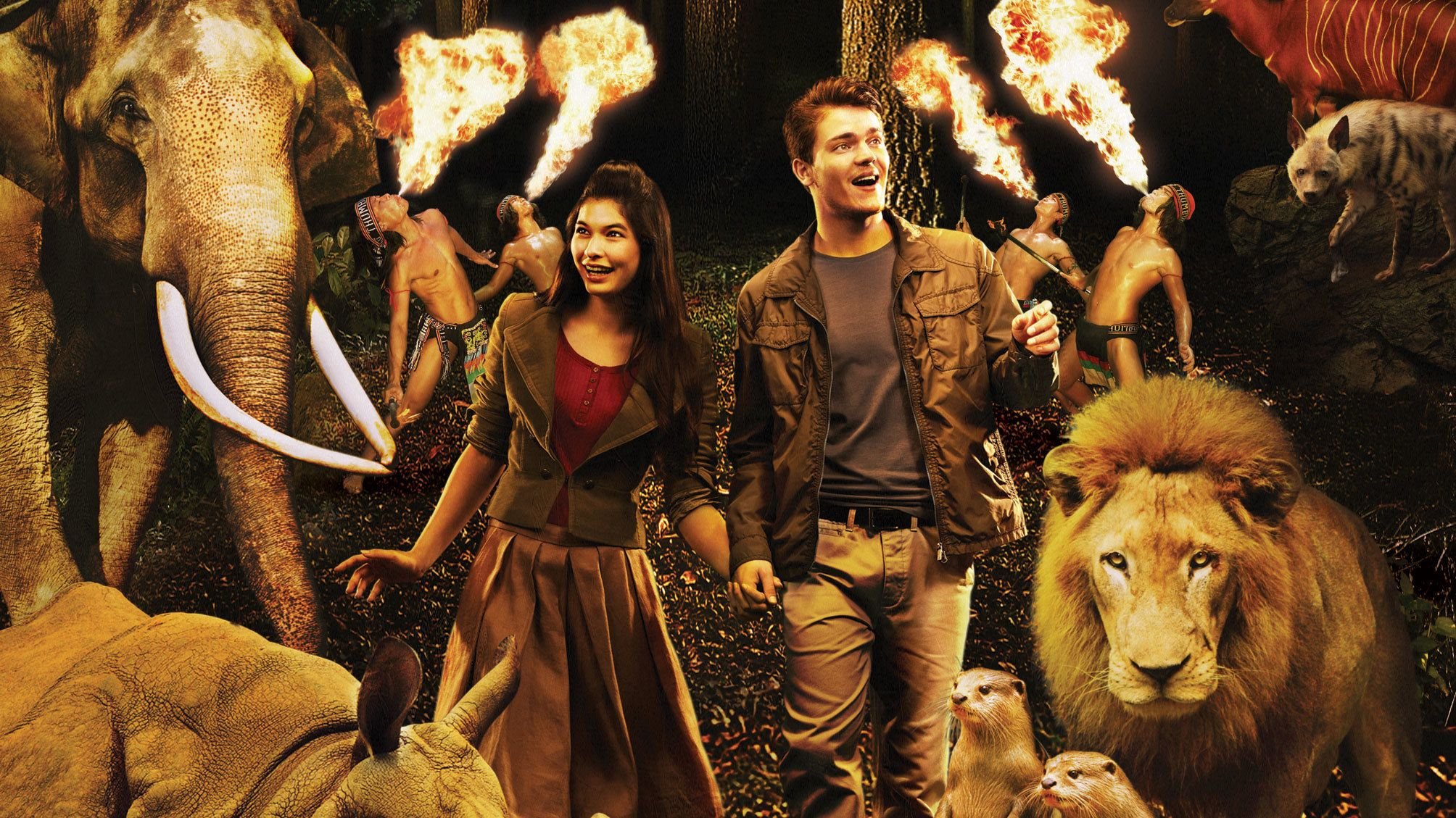 Couple surrounded by animals and men breathing fire on back ground for Night Safari attraction in Singapore