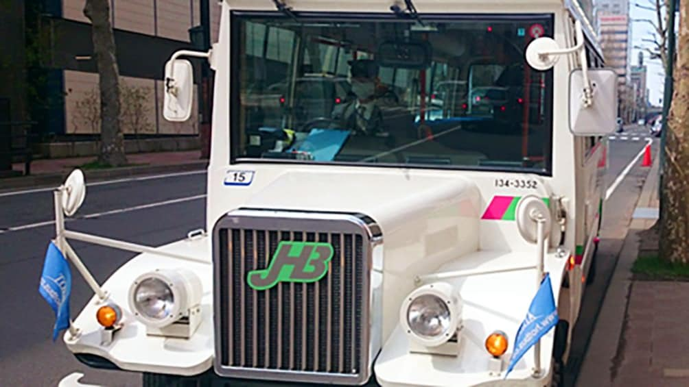 Show item 5 of 5. Tour bus in Tokyo
