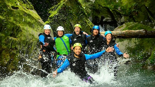 Climbing group in a stream in in Kawarau Canyon