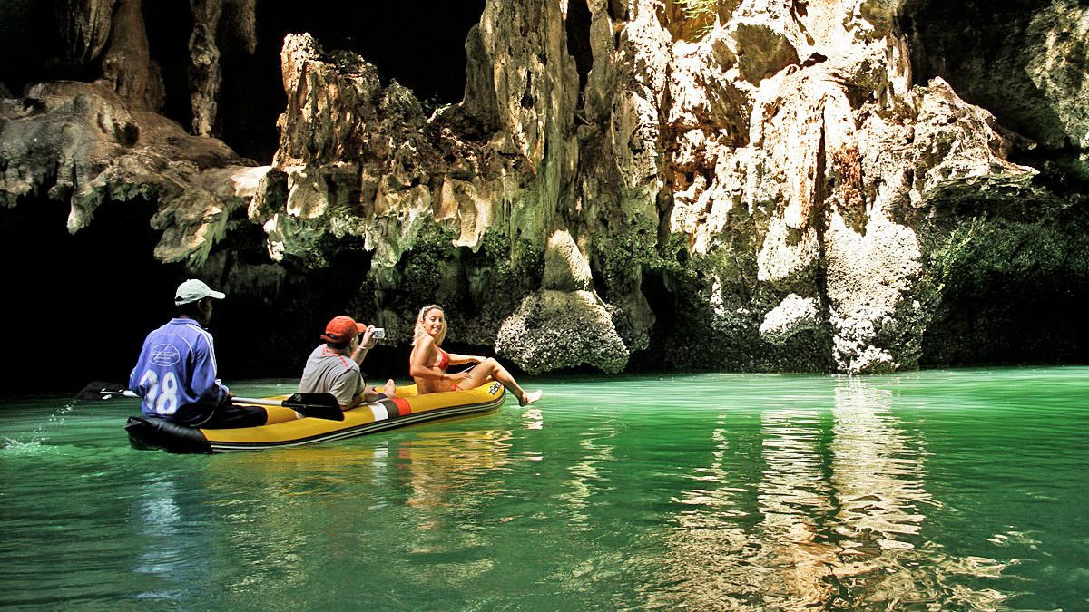 Guests enjoying a scenic view of the caves in Phuket