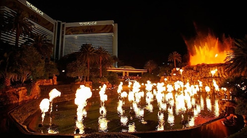 View of display pool in front of hotel with multiple flames throughout the pool in Las Vegas