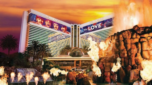 View of the Mirage Hotel from the rock display with flames in front of hotel at night in Las Vegas