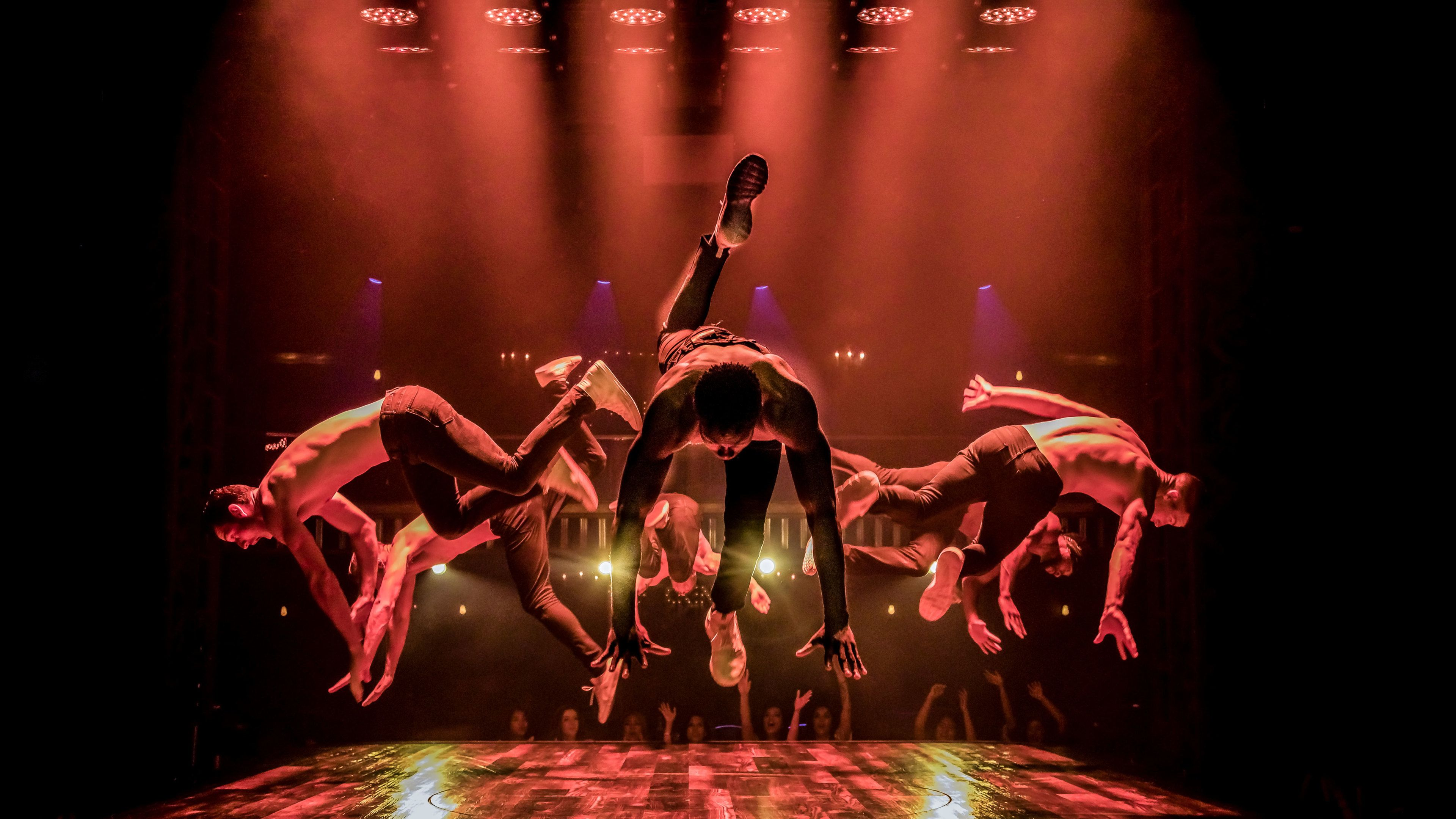 Magic Mike performers in middle of dance on stage at Hard Rock Hotel & Casino Las Vegas