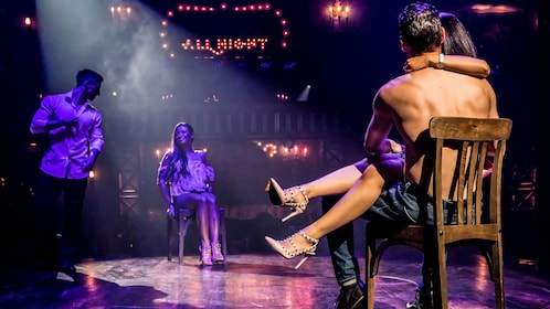Performers interact with audience women on stage during Magic Mike show at Hard Rock Hotel & Casino Las Vegas