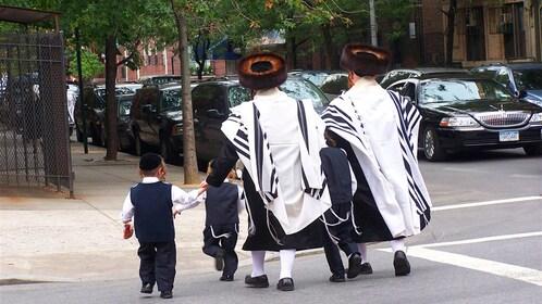 Jewish family walks across the street