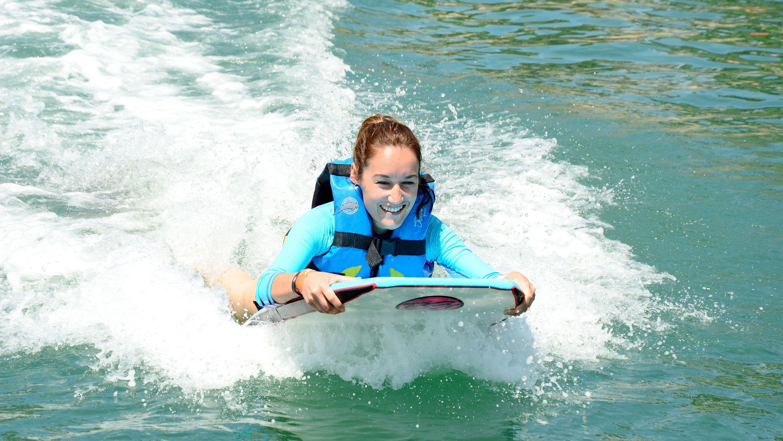 Woman enjoying the Cozumel Dolphin Swim Adventure