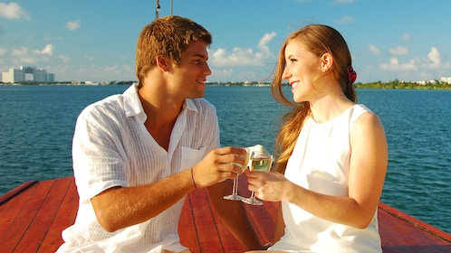 A young couple drinking on a boat in Mexico
