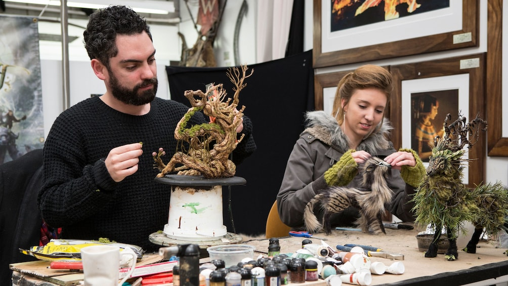 Show item 2 of 7. Artists making miniature models at the Weta workshop in Wellington