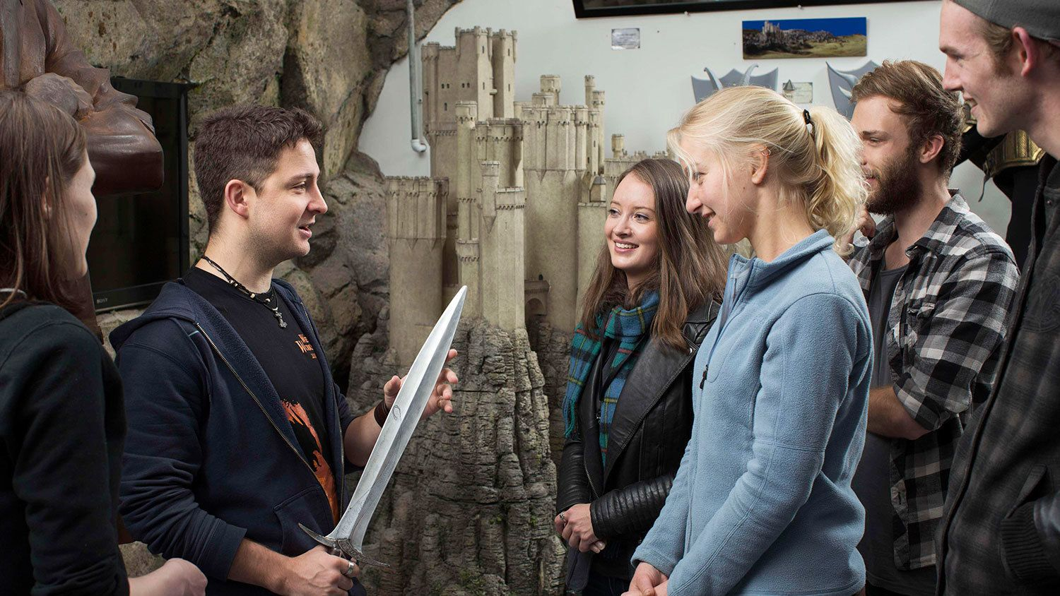 Tour guide holding Frodo's sword from the Lord of the Rings