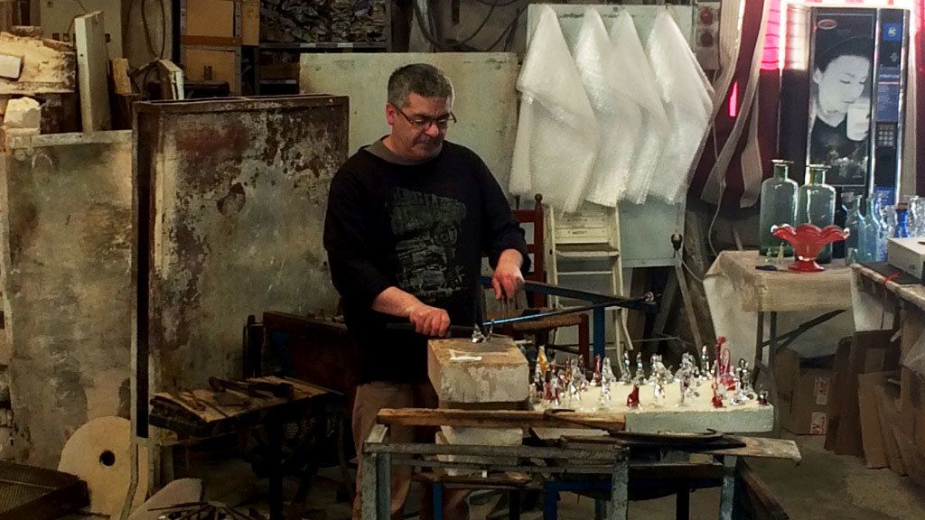 Glass maker creating small pieces of work in studio in Barcelona