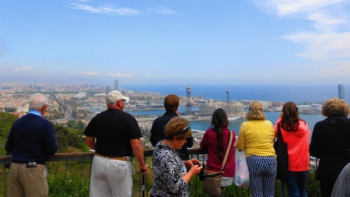 Group of tourists looking out toward Barcelona
