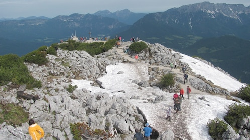 People walk on a glacier of the Bavarian Alps