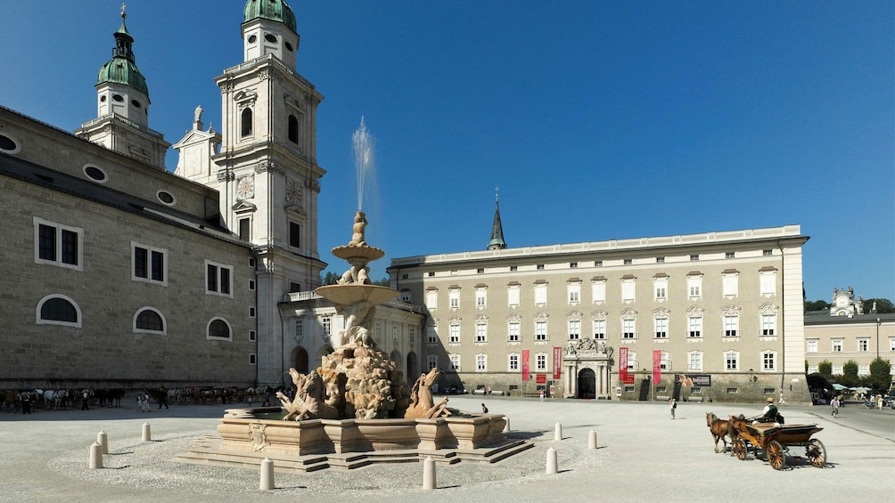 Show item 2 of 5. Fountain in a courtyard of a large building in Salzburg