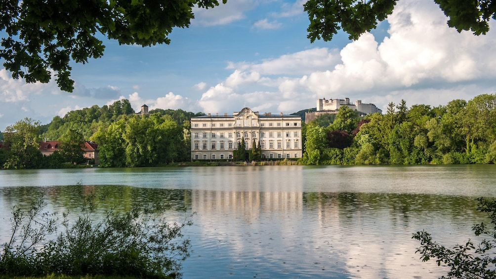Show item 1 of 5. View of a palace across a lake in Salzburg