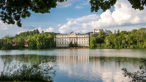 View of a palace across a lake in Salzburg