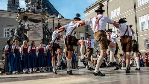 Men in lederhosen dancing in a circle in Salzburg