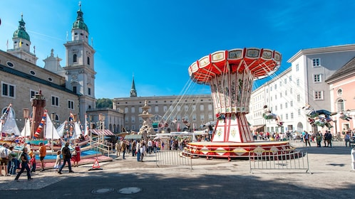 Carousel swing ride in a city square in Salzburg