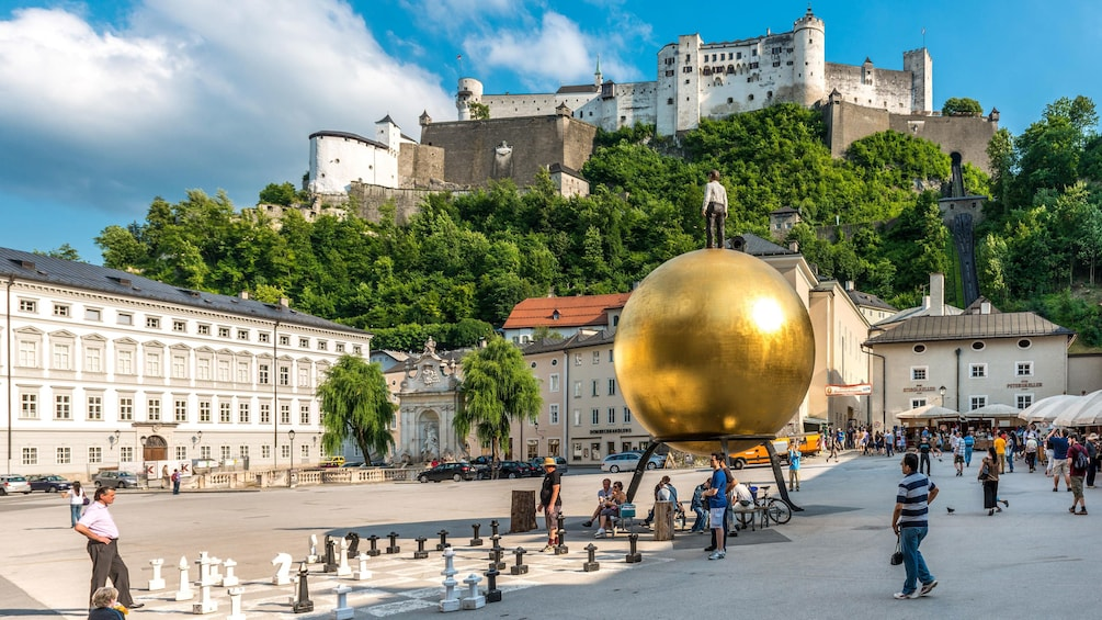Show item 4 of 5. Gold ball sculpture in Salzburg