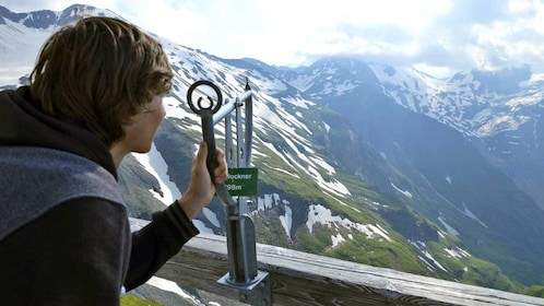 boy using a view finder on top of the mountains in Salzburg