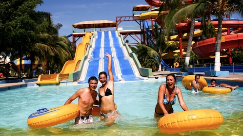 Group with inner tubes at the bottom of a waterslide