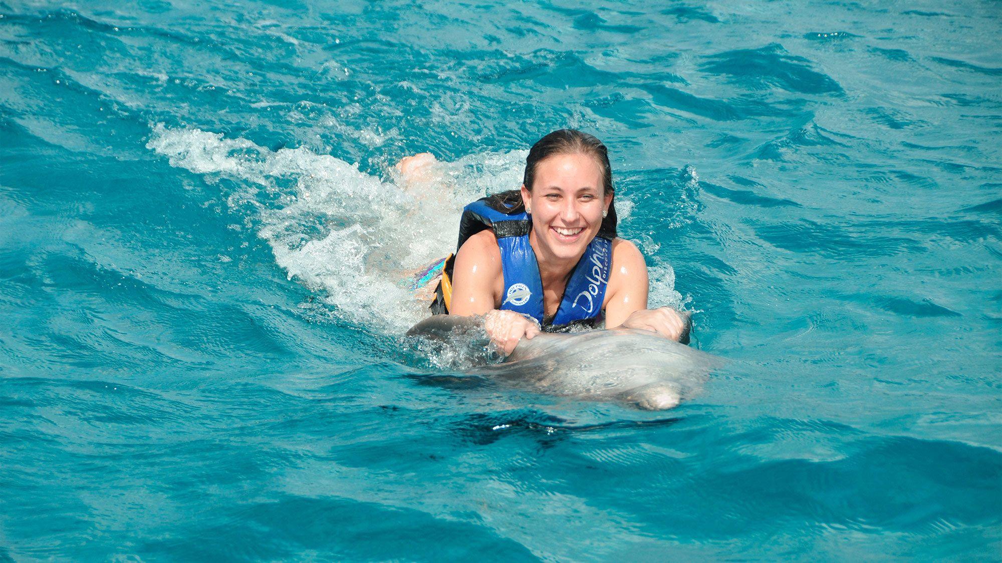 Woman enjoying the Dolphin Swim Adventure in Punta Cana
