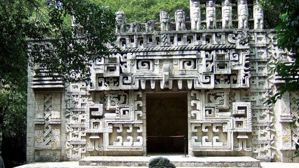 Show item 1 of 9. Complex stone carved structure outside of the anthropology museum in Mexico City