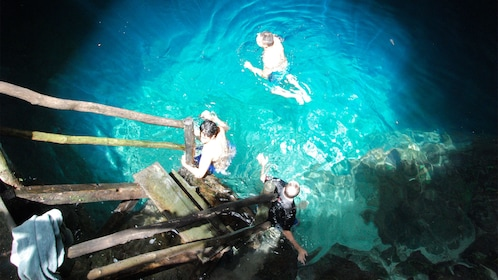 Guests swimming on the Cuzama Cenotes Tour