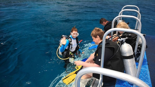 Busy scuba drivers getting ready on boat to explore the Great Barrier Reef in Australia.