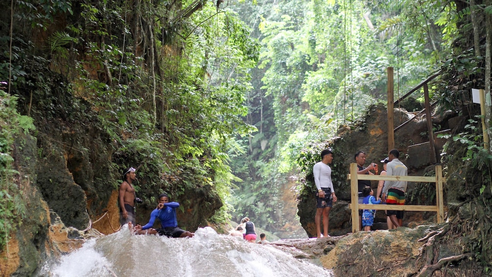 Show item 3 of 10. Tourists enjoying water falls in South Coast