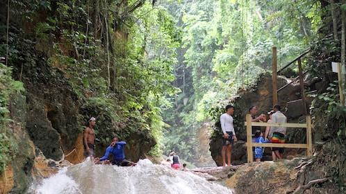 Tourists enjoying water falls in South Coast