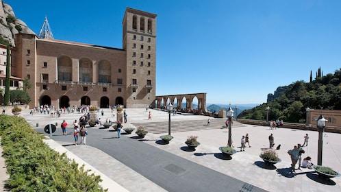 Tourists walking outside Santa Maria de Montserrat