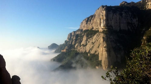 Striking view of mountains emerging from the mist in Montserrat
