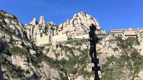 Looking up at Santa Maria de Montserrat nestled in the mountains of Montserrat