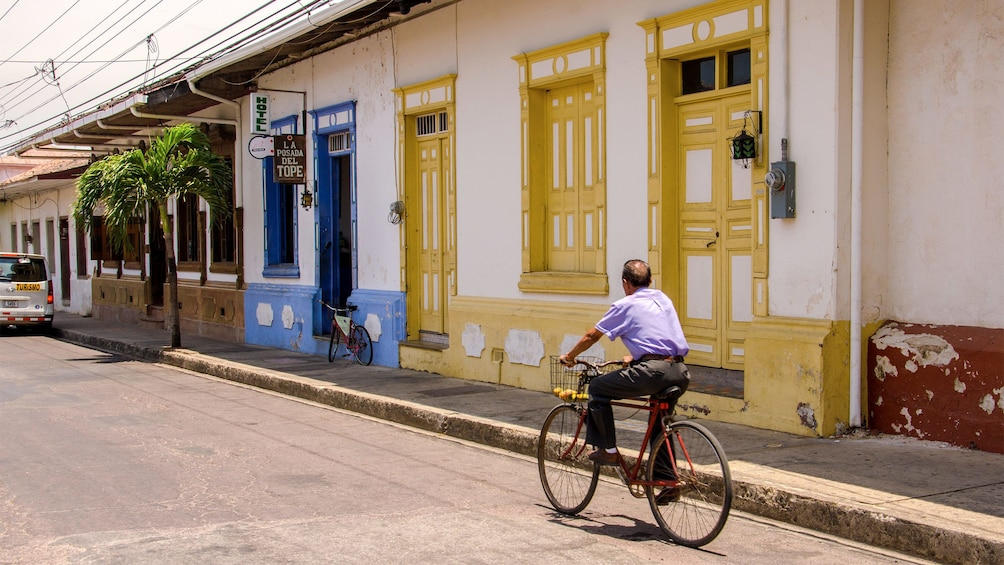 Show item 7 of 7. Street view of a man bicycling in in Costa Rica