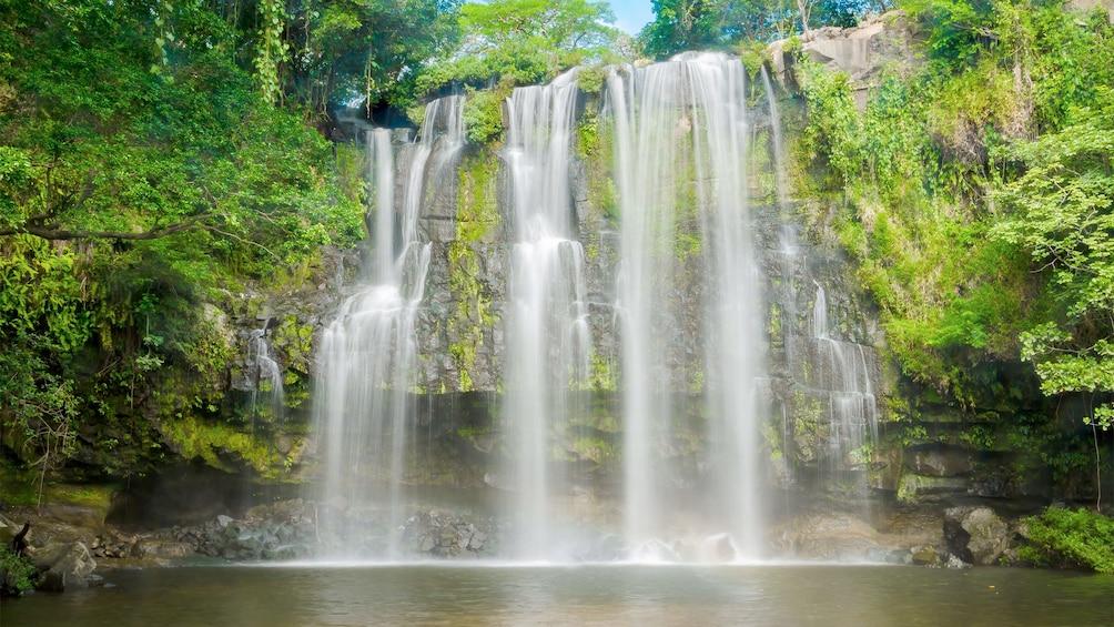 Show item 1 of 7. Bebedero River Boat Safari view of the waterfalls in Costa Rica