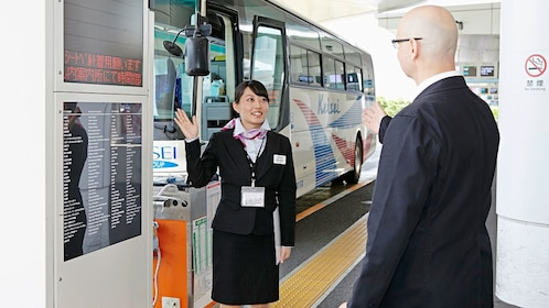 Airserve employee directing client outside of airport in Tokyo