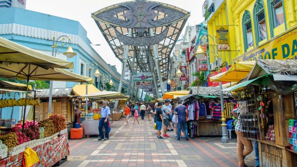 Street vendors in shopping district in Kuala Lumpur