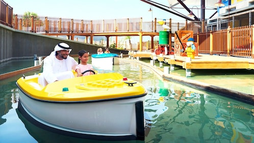 Father and daughter in boat at Legoland Dubai