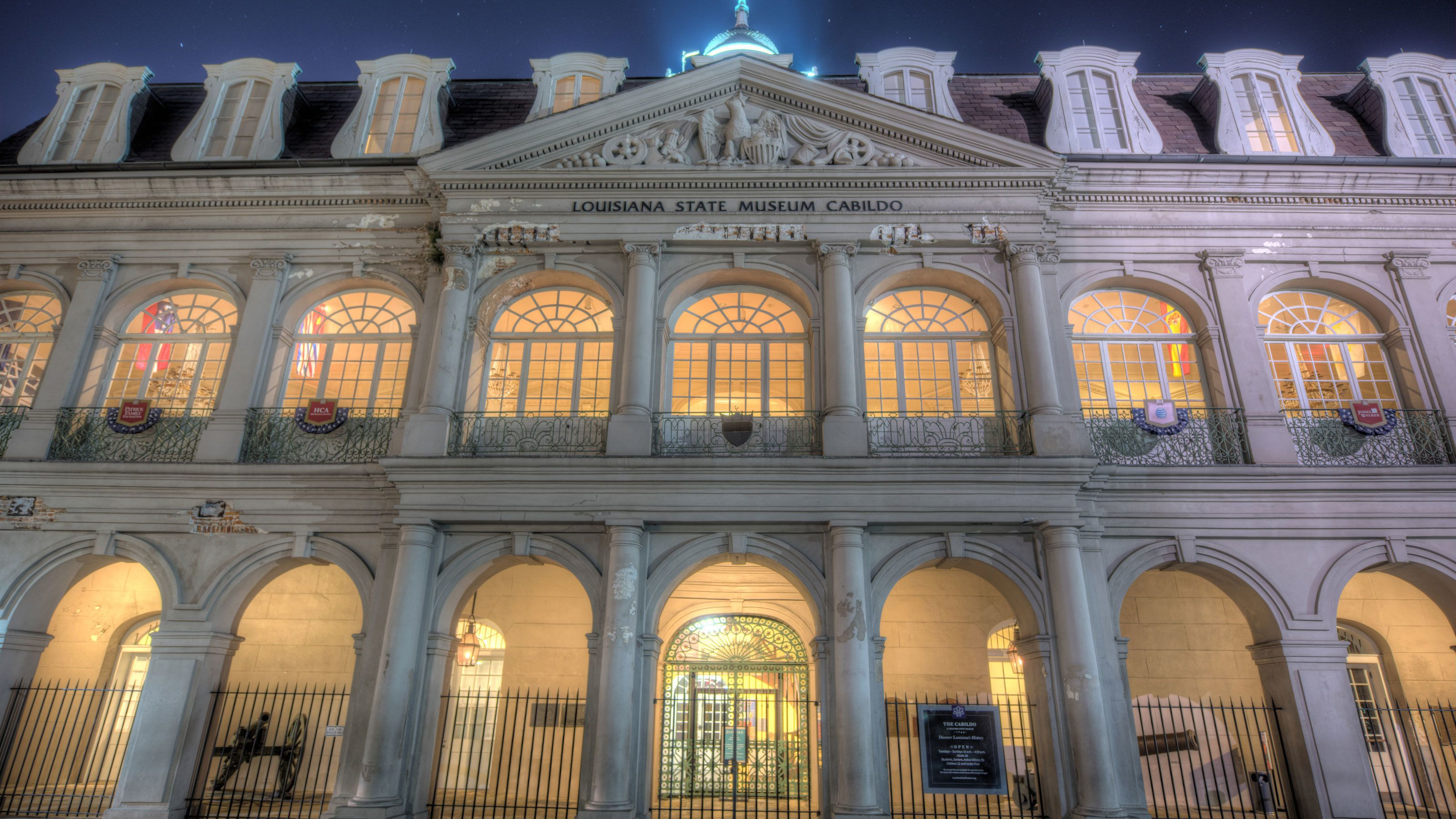 The front of the Bourbon Orleans Hotel at night in New Orleans