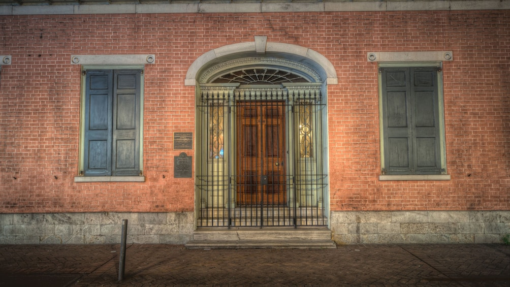 Show item 2 of 5. The front door and gate of the Herman-Grima House in New Orleans