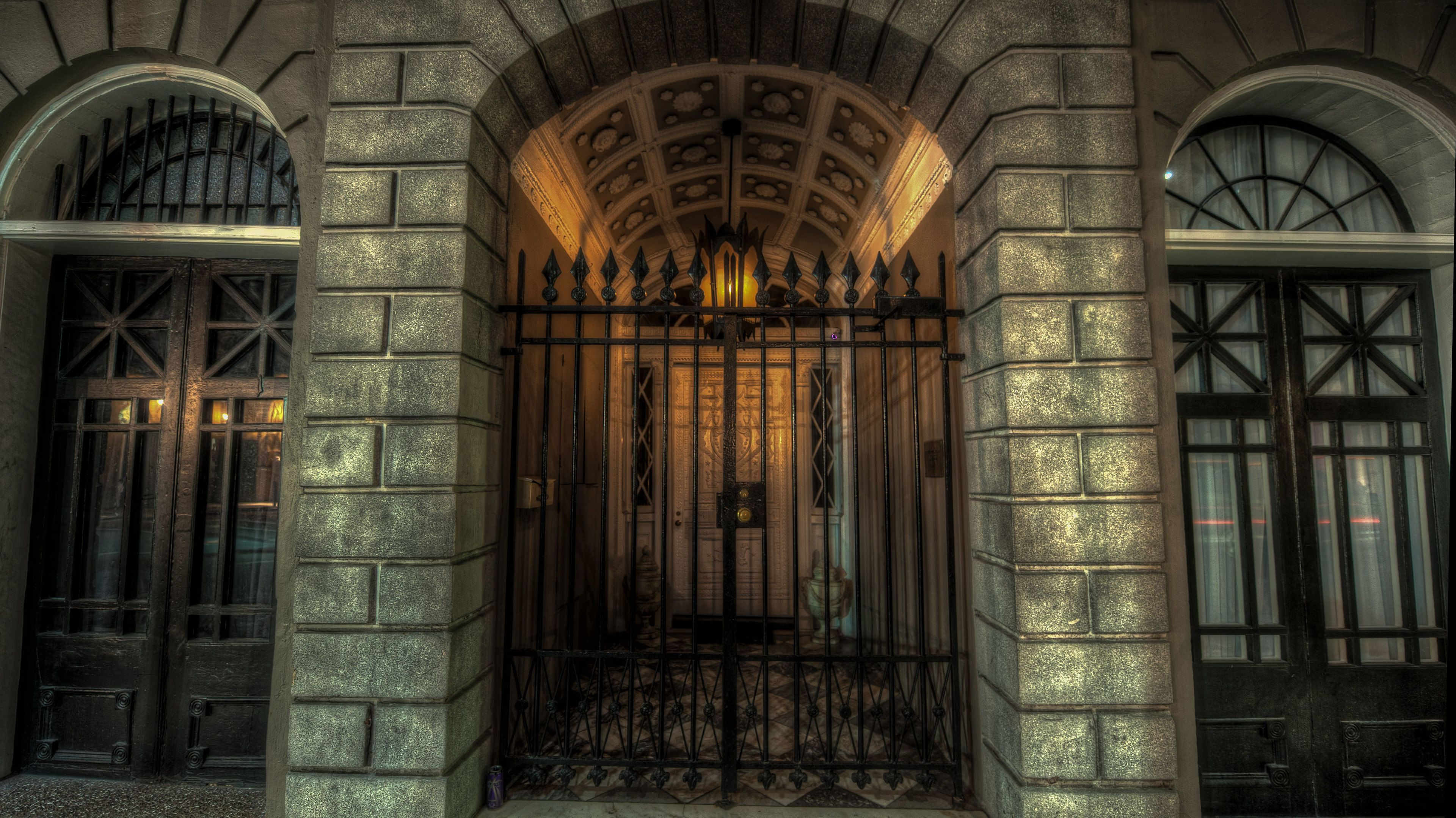 Raw iron gate at beginning of hallway at exterior of building in the French Quarter in New Orleans